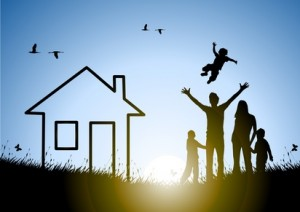 Happy family and house at sunset in a meadow